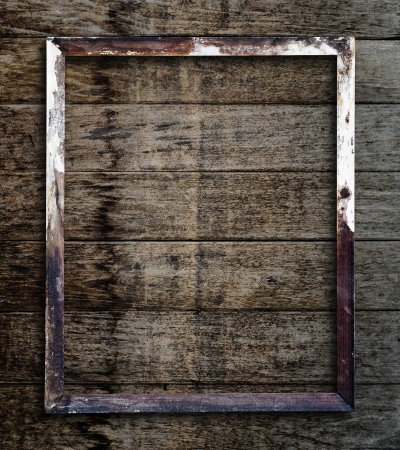 Old picture frame on vintage wood wall. Stock fotó