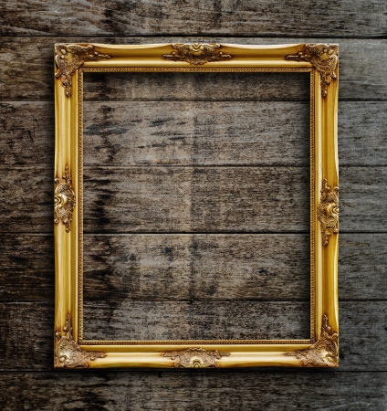 Old picture frame on vintage wood wall Stock Photo - 15821566