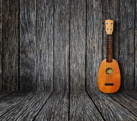 Ukulele in vintage wood room  Stock Photo