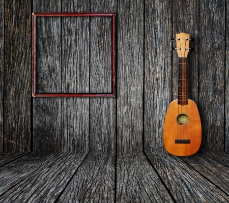 Ukulele and picture frame in vintage wood room  photo