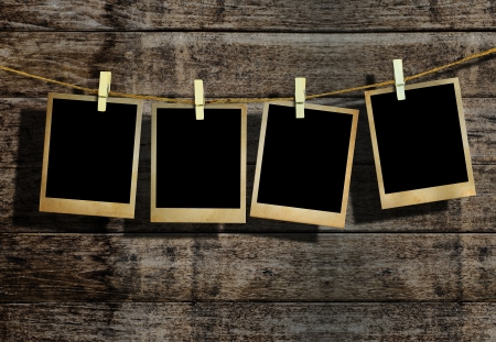 picture person: Picture frame hanging on clothesline on wood background