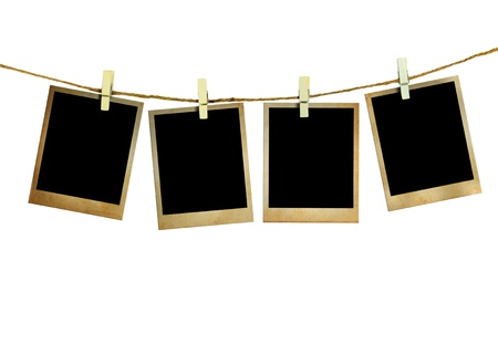 Old picture frame hanging on clothesline white background  photo