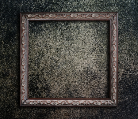 golden border: Old picture frame on grunge wall
