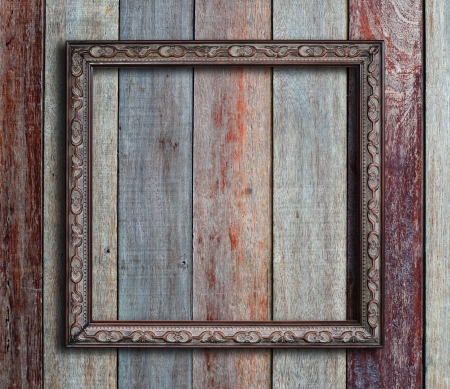 simple border: Old picture frame on vintage wood wall