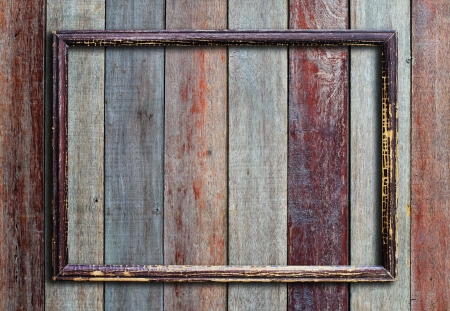 fancy border: Old picture frame on vintage wood wall. Stock Photo