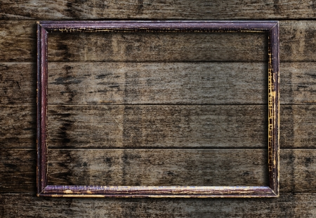 mirror frame: Old picture frame on vintage wood wall. Stock Photo