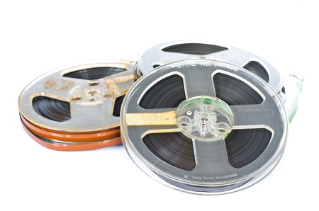 old spools: Magnetic tape on white background