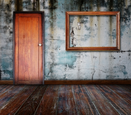 Picture frame put on wall in grunge room Stock Photo - 15859195