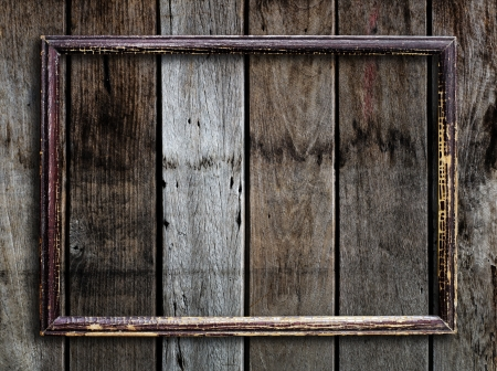 wooden frame: Old picture frame on vintage wood wall. Stock Photo