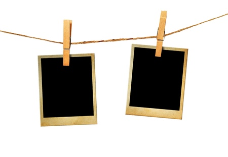 Old picture frame hanging on clothesline white background. photo