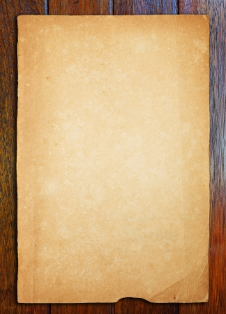 Old paper on wood table Stock Photo - 16357349