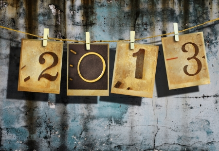 Old clock photos hanging sort 2013 words on wood background  New year 2013 and christmas 2013  photo