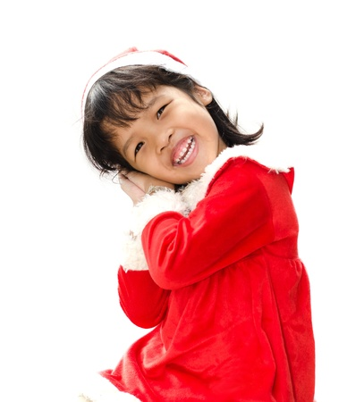 little girl dressed as Santa Claus  photo