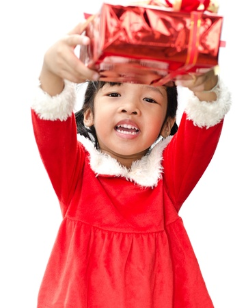 little girl dressed as Santa Claus with christmas gift  photo