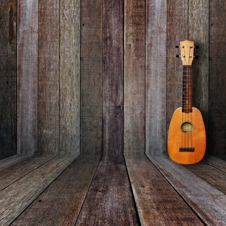 Ukulele in vintage wood room. photo