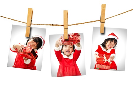 Photos of little girl wearing Santa Claus hat  hanging on white background.