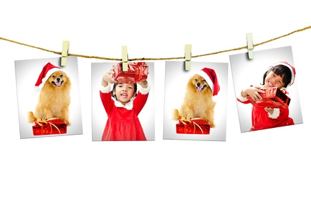 Photos of little girl and dog wearing Santa Claus hat  hanging on white background. photo