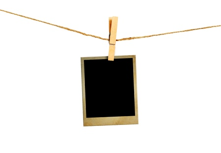 Old picture frame hanging on clothesline on white background. Stock Photo