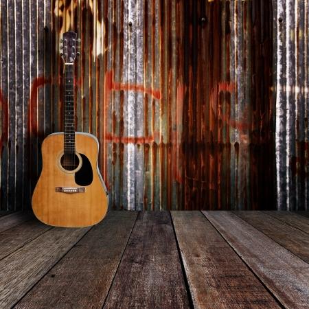 Guitar in grunge room  Stock Photo - 17366168
