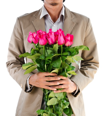 birthday suit: Man in suit holding a roses on white background.