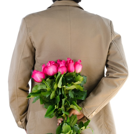 Man in suit holding a roses on white background. Stock Photo - 17452271