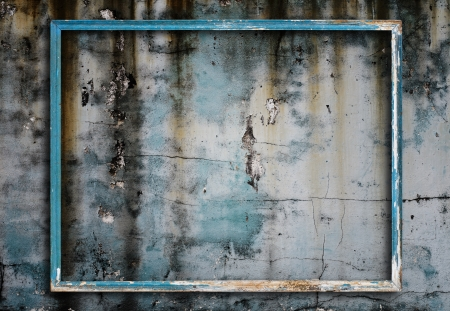 distressed wood: Old picture frame on grunge wall