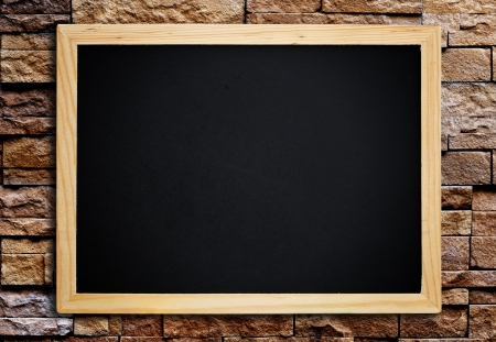 Blackboard on vintage wood wall. photo