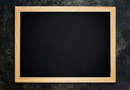 Blackboard on vintage wood wall. photo