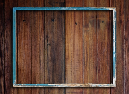 grungy background: Old picture frame on vintage wood wall. Stock Photo