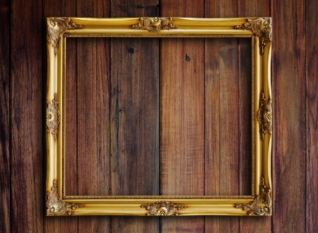Old picture frame on vintage wood wall Stock Photo - 18251813