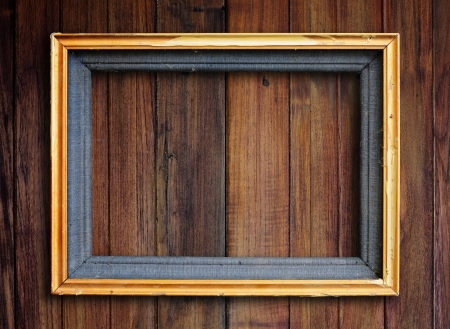 gold picture frame: Old picture frame on vintage wood wall