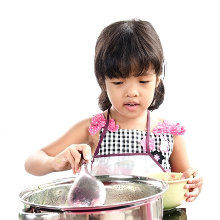 Little girl made jelly on white background  photo