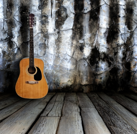 country music: Guitar in grunge room.