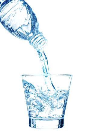 soda splash: Pouring water on a glass on white