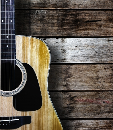 acoustic guitar: Guitar on wood background