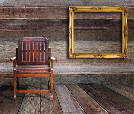 Picture frame and wood chair in wood room  photo