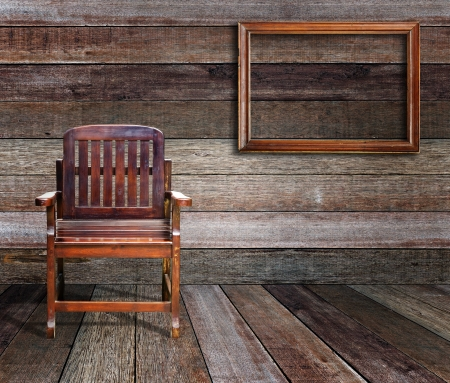 picture frame on wall: Picture frame and wood chair in wood room  Stock Photo