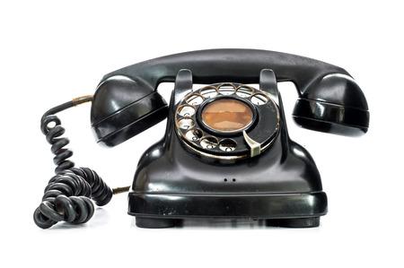 Old telephone on white background  Foto de archivo