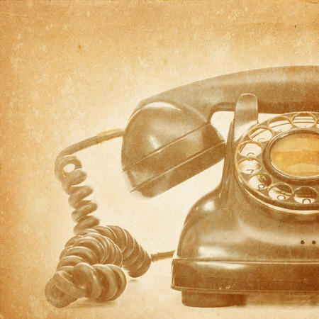 Old telephone on grunge background  Foto de archivo