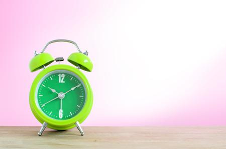 ten empty: Alarm clock put on the wooden in pink wallpaper room.