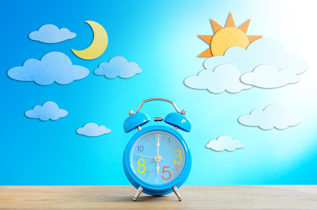Alarm clock and paper craft, Day and Night Sky photo