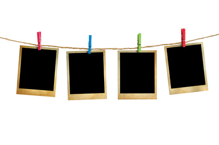 Old picture frame hanging on clothesline white background. 版權商用圖片 - 27877054