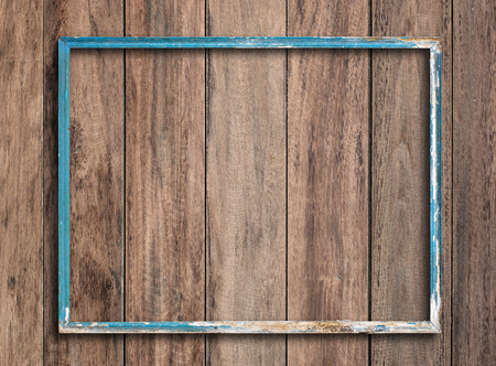 distressed wood: Old picture frame on vintage wood wall. Stock Photo