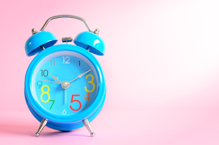 ten empty: Alarm clock on pink background.