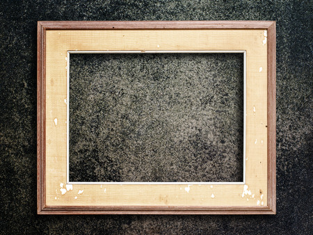 vintage photo frame: Old picture frame on grunge wall. Stock Photo