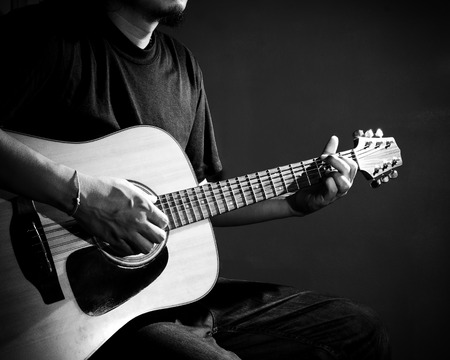 playing the guitar: Man playing guitar. Black and white photo.
