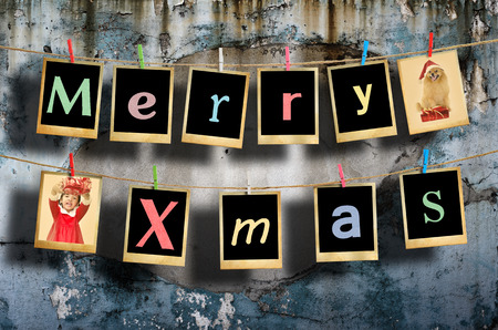 Merry christmas words hanging on clothesline on grunge background. photo