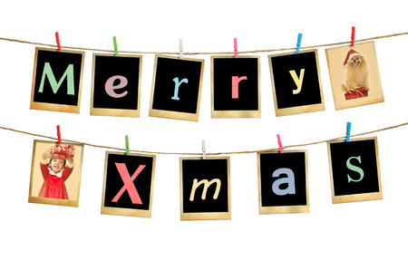 Merry christmas words hanging on clothesline on white background. photo