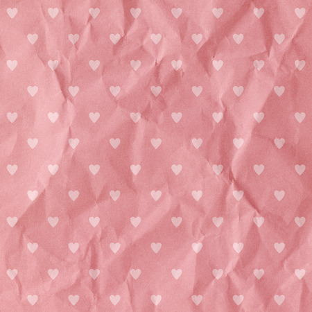 Hearts patten on paper texture background. photo