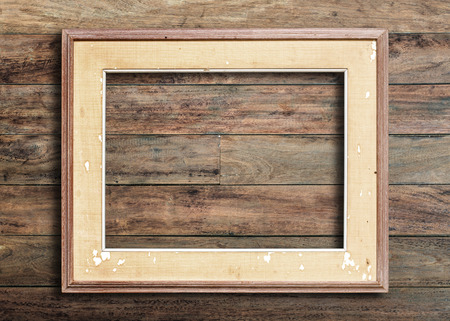 wood room: Old picture frame on vintage wood wall. Stock Photo